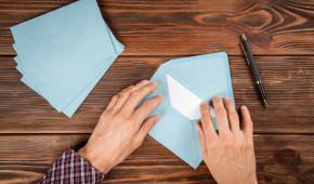 Man's hands holding an envelope